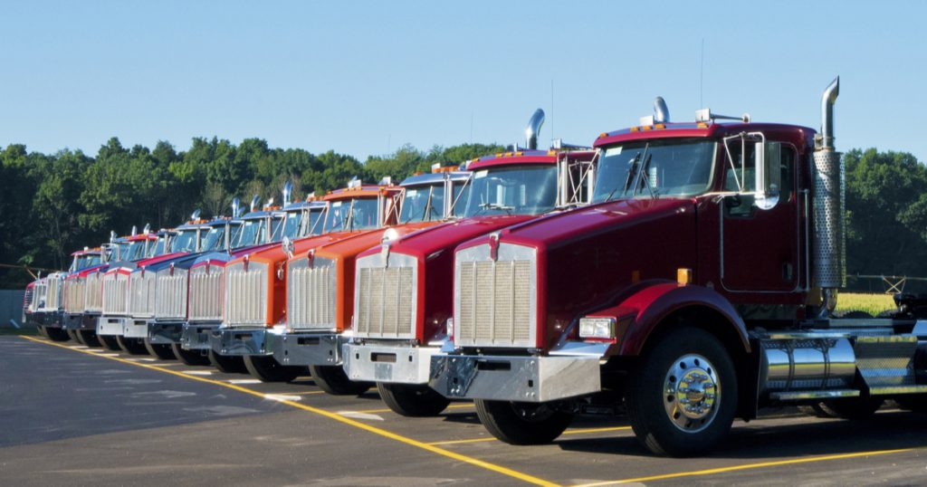 Trucks parked in a row from a company using the COVID-19 CARES ACT stimulus money.