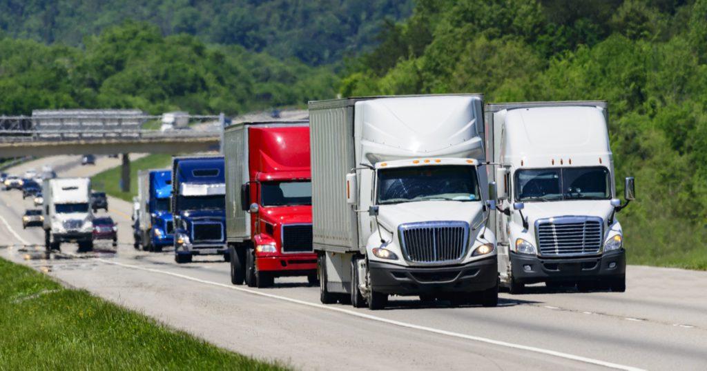 Trucks driving down interstate, making IRS Form 2290 Amendments