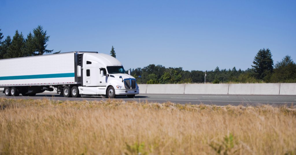 Truck driving down interstate, making IRS Form 2290 Amendments