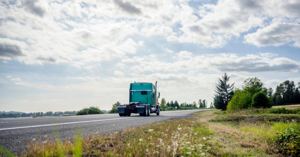 Green bobtail truck with FMCSA HOS changes