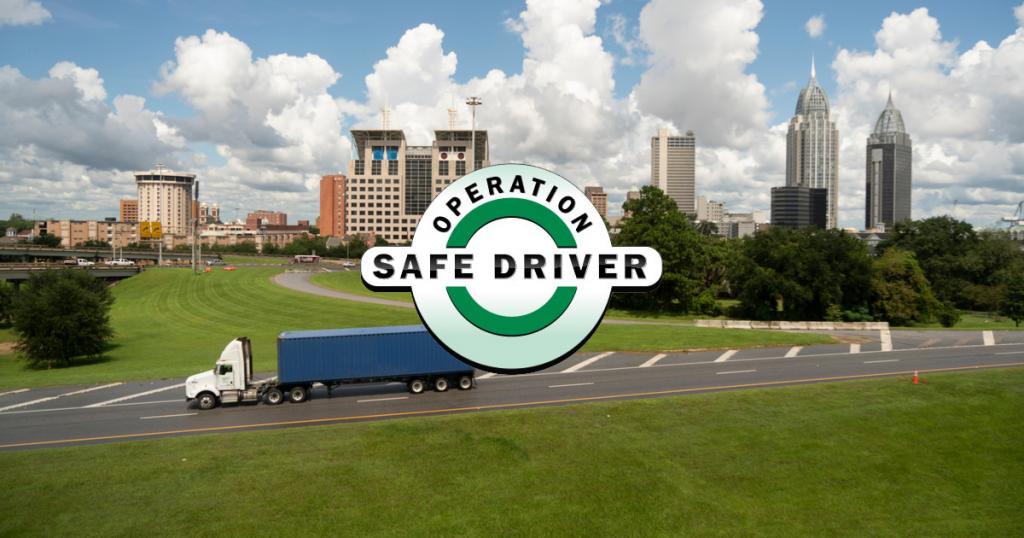 Truck on interstate preparing for CVSA operation safe driver week 2020